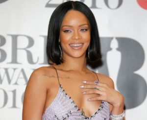 Rihanna Sues her father for fraud